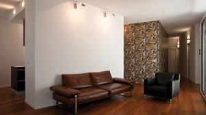 Casa M10 Foto della zona soggiorno dell'alloggio al piano primo.