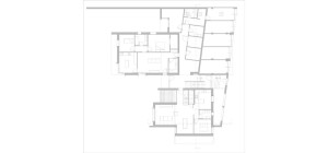 Casa M10 Planimetria del piano terra. Alloggio adiacente a zone comuni, zona giorno della villetta e batteria dei garages.