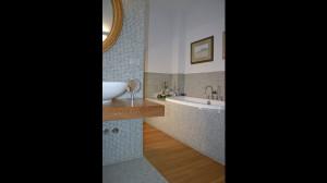 Casa B04 Foto del bagno padronale al piano primo. Rivestimento e pavimento in mosaico. Pedana in listelli di rovere.